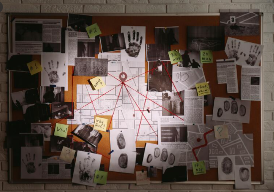 The room is a full of mess but there is a big board hanging on the wall which is full of notes and sketches