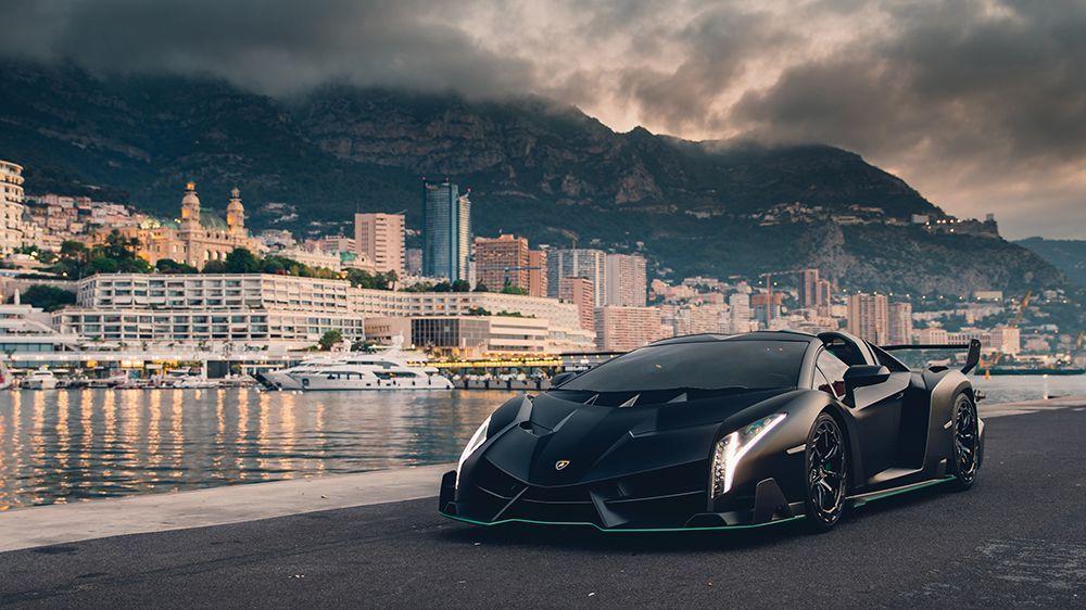 She wraps her arm around his, and the pair walks toward his Lamborghini Veneno