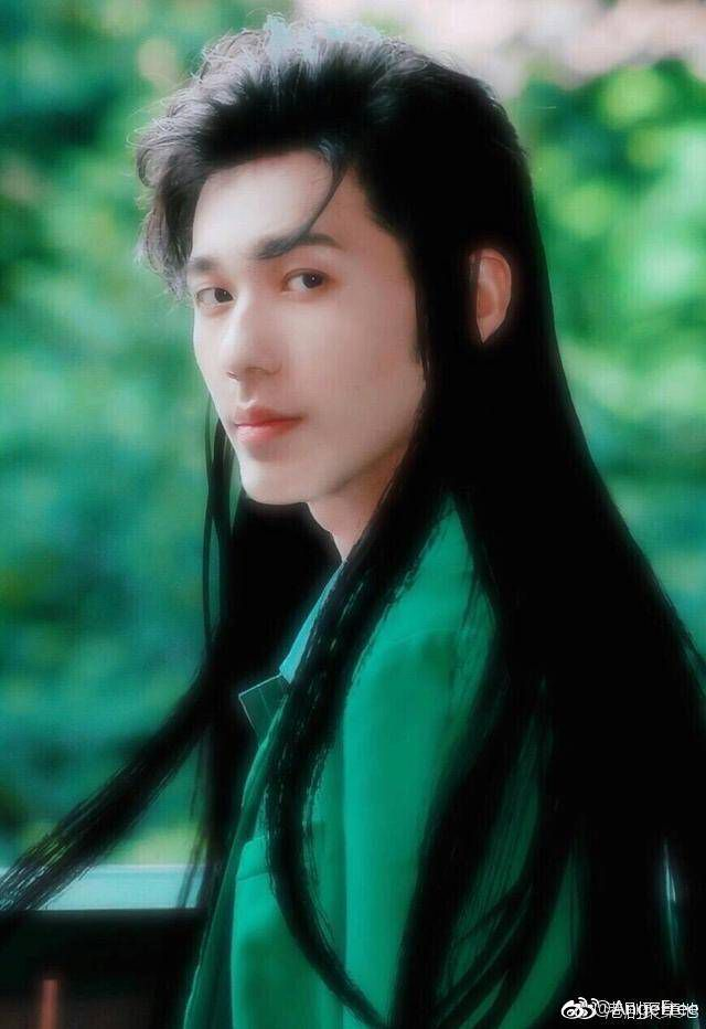 Long dark hair flowed down a strong back, a lean body born from  years of  martial training and war sprawled over his own