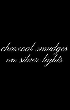 charcoal smudges on silver lights by SmokeDemon777