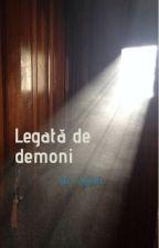 Legată de demoni  de anonym2009